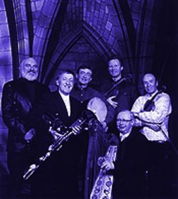 The Chieftains, from left, Matt Molloy, Paddy Moloney, Kevin Conneff, Sean Keane, Derek Bell (in front) and Martin Fay.
