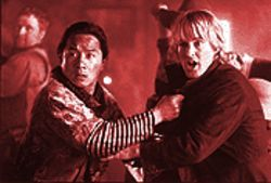 Jackie Chan and Owen Wilson can't seem to decide if they're in a parody or a tribute.