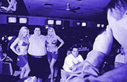 At &quot;Extreme Bikini Bowling,&quot; some bowlers pose with models while others rebel against Evil Ed.