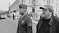 Michael Moore (right) takes his case to Capitol Hill.