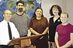 The Calderwood school staff includes (from left) teachers Mike Larson and Peter Newberg, office support staff Gina Holt and Jeri Ward, and administrator Amy Perhamus.