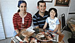 The Zankana siblings (from left), Aya, Saman, and cute little Nour, help make Fattoush a family affair.