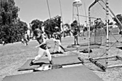 Kids test training equipment at a recent Little League   event in Chandler.