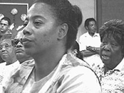 South Phoenix residents attend a meeting in June 2001 to discuss the dangers to them of the Central Garden fire.