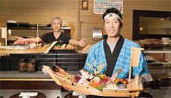 What a catch: Chef Kazuto Kishino (left) and sushi chef Rick &quot;Koji&quot; Hashimoto show off the seafood at Hana.