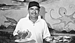 Seafood, eat it: Chef Ricardo Serrano with his briny bounty.