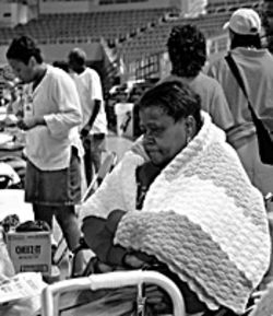 New Orleans evacuee Veronica Lewis bundles up with a donated shawl at the Veterans&#039; Memorial Coliseum evacuation center in Phoenix.