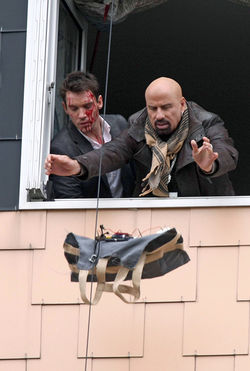 Bombs away: Travolta and Jonathan Rhys Meyers