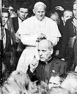 Marcinkus, front, clearing the way for Pope John Paul II on an early U.S. tour.