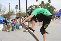 Spectators look on as Shawn Short performs his tricks during The Wedge's 9th annual skateboarding competition, Saturday, March 15, in Scottsdale.
