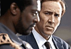 War games: Nicolas Cage (right, with Eamonn Walker) portrays a ruthless arms dealer in Lord of War.