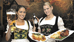 Getting the boot: Die Fr?ein at Black Forest Mill serve up cold beer and hot wiener schnitzel.