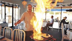 Owner Abrahim Khoshaba fires up some saganaki: a slice of sheep's-milk cheese, doused with brandy, ignited, then extinguished with a squeeze of lemon.
