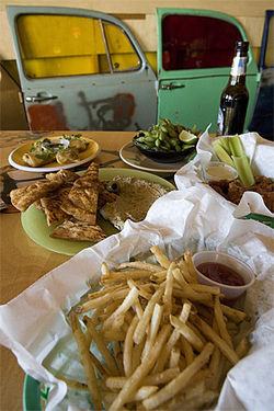 Rabbit food it's not: French fries, fried pita with hummus, and other vegan splurges.