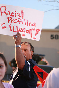A protester at the April 3 demonstration outside Guadalupe&#039;s Family Dollar store.