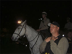 Army of the night: Mounted MCSO deputies advance on the demonstrators protesting Arpaio's April anti-immigrant sweep in Guadalupe.