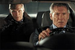 Ford escort: Harrison Ford (right) must follow Paul Bettany's orders if he hopes to save his family in Firewall.