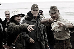 From left, interpreter Yuki Ishimaru, director Clint Eastwood, and actor Ken Watanabe on the set of Letters From Iwo Jima.