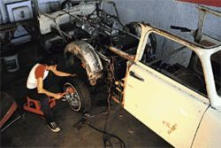 Liz Cohen works on the Trabant  here the car is expanded to El Camino size.