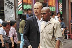 Police action: Bruce Willis is a cop who must escort witness Mos Def to safety in 16 Blocks.