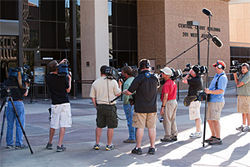 A crush of national and local media await the Grant trial verdict outside the courthouse in downtown Phoenix.