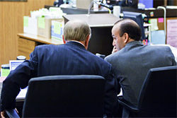 Doug Grant looks over at his lawyer, Mel McDonald, during trial testimony.