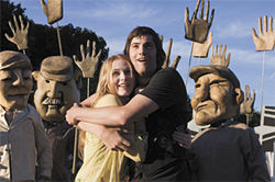 All you need is hugs: Evan Rachel Wood and Jim Sturgess cheapen the Beatles in Across the Universe.