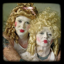 Mike Ford's photograph The Dolls portrays the artist (left) and his mother.
