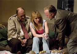 Cryin' Ryan: Amy Ryan, perfectly the single febrile woman, with John Ashton and Ed Harris in Gone Baby Gone.