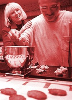 Dough nuts: Steve Silver makes cookies as wife Roz  looks on.