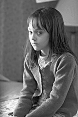Staged frights: Dakota Fanning is a child with a secret in Hide and Seek.