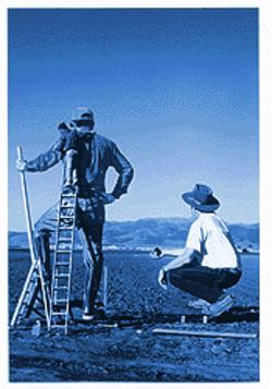 Artist John Serney (on ladder) with friends in Salinas, California.