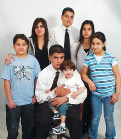 The Almaleki children, circa 2005 (Noor is standing second from left and Ali is in the center, holding the child).