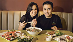 Double happiness: Dragonfly owners Mike Nguyen and his wife, Linh Ly, feast on Vietnamese specialties.