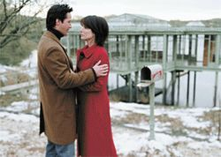 Worlds collide: Keanu Reeves and Sandra Bullock in one of the more action-packed scenes from The Lake House.