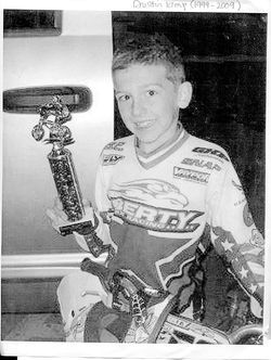 Dustin Kemp, showing off  a BMX trophy.