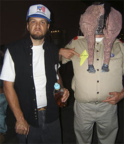 Jason Odhner (left) as Arpaio fan Buffalo Rick Galeener and John Norris as Sheriff Joe the horse&#039;s keister.