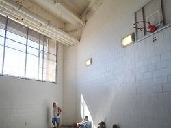 Immigrants find a sliver of sunlight inside the Pinal County Jail, which doesn't allow such detainees to go outside.
