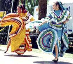 Loco motion: Flourishes of color from dancers at Mesa's fiesta.