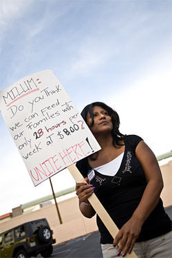 Eva Guzman, protesting her former employer, Milum Textile Service.