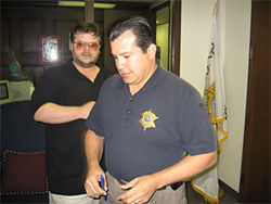 Arpaio&#039;s chief spokesman, Captain Paul Chagolla (foreground)