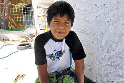 "Eight-year-old Esteban, pictured standing outside his family's house, first saw dead bodies two years ago, in a car four blocks from home. He asked his father: ""Even if they did something really bad, they didn't deserve to die, right, Daddy?"""