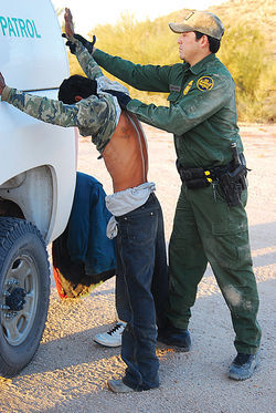 The U.S. Border Patrol searches a suspected smuggler.