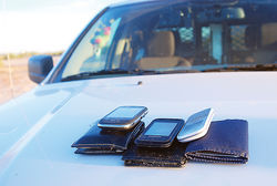 Confiscated wallets and phones that smugglers used to communicate with drivers and lookouts.