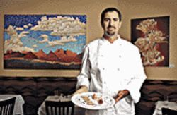 Grand gourmet: Chef Kevin Binkley with one of Lemons&#039; faves, a veal tenderloin appetizer with saffron potato salad and vanilla grape tomatoes on endive, the plate drizzled with balsamic reduction.