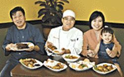 Family affair: Three generations serve up the Indo-eats. From left, Ali Lie (grandpa), chef Abraham Indradjaja, his wife, Lielis Ali, and daughter Evelyn.