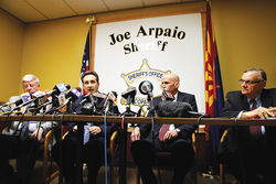 At a December news conference, Joe Arpaio listens to questions about botched sex-crimes investigations under his watch.