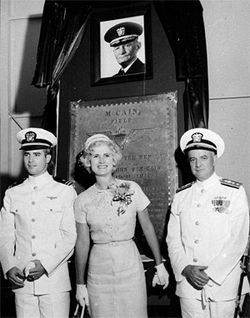 John S. McCain III (left) and his parents, Rear Admiral John S. McCain Jr. and Roberta Wright McCain, attend a ceremony commissioning McCain Field, a Navy training base in Mississippi, named for the senator&#039;s grandfather, Admiral John S. McCain (in photo at top), in 1961.
