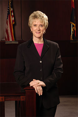 Ruth McGregor, chief justice of the Arizona Supreme Court, is forced to fight the memory of a judge who lost his job 17 years ago.