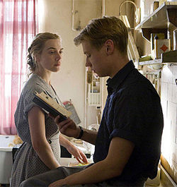 Bedtime story: Kate Winslet and David Kross between a moment of carnal abandon in The Reader.
